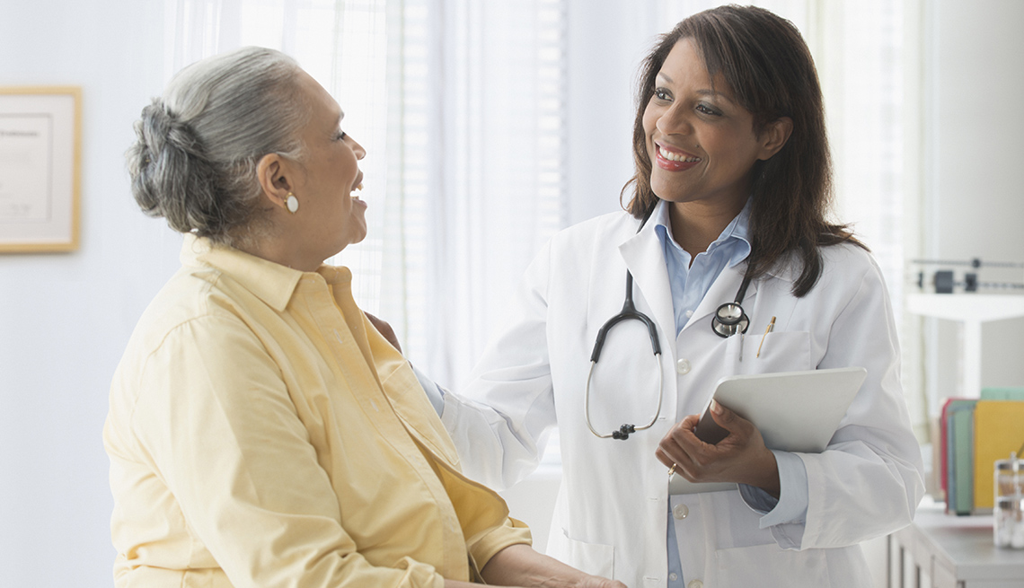 Mature African American Woman Talks To Doctor, Questions To Ask Your Doctor