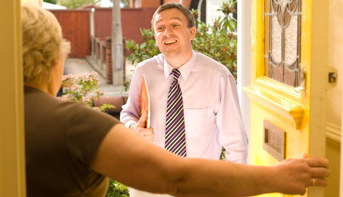 Door to Door Salesman Woman Opening Door, Protect Your Loved Ones from Scam Artists, Caregiving