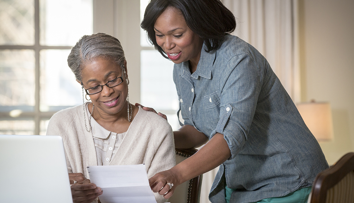 Mature African-American Woman, Daughter Helping Laptop, 5 Tips for Discussing Money Matters With Family
