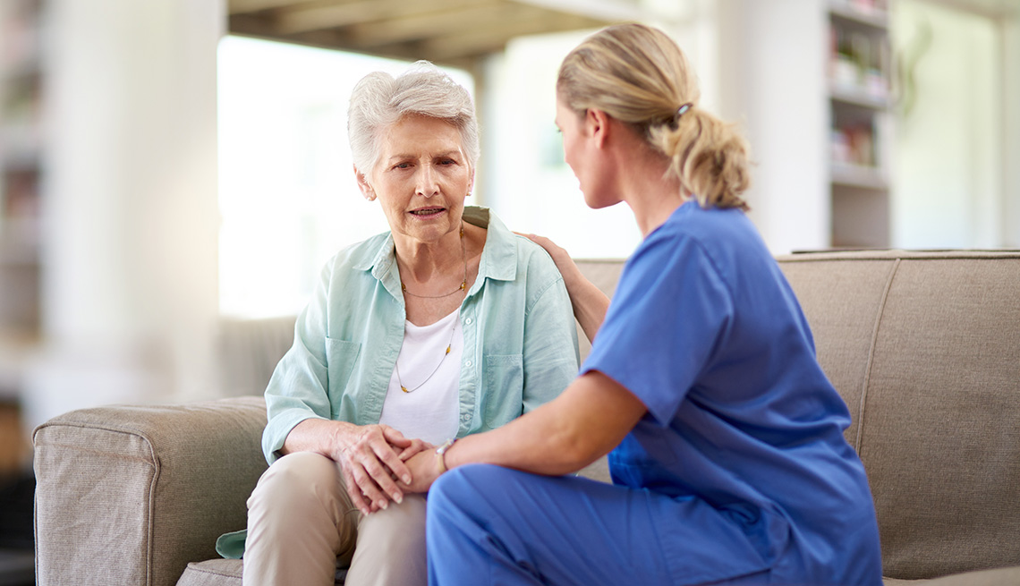 Elderly Caucasian Woman Patient Sits With Nurse, How To Assess The Mental Health of Older Adults