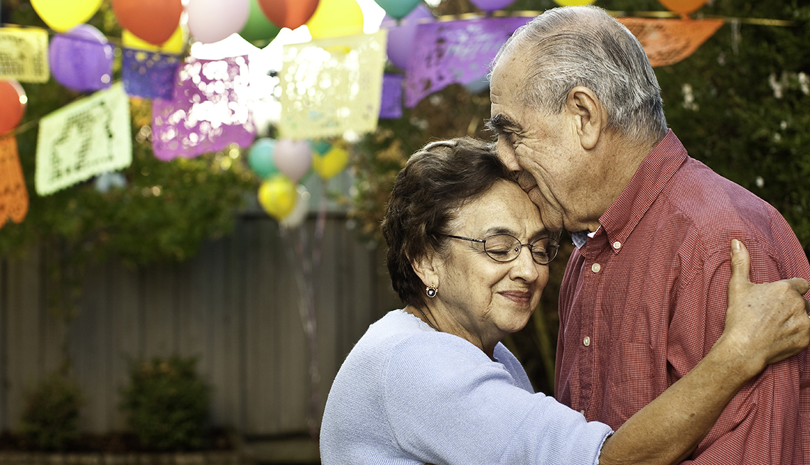 Mature Hispanic Couple Embrace, Outdoor Party Balloons, Creating a Living Will, Health Care Power of Attorney