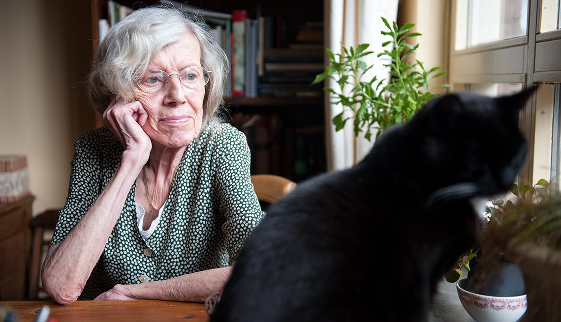 Senior Woman Staring Window, Cat on Table, What's Happened to My Mother?