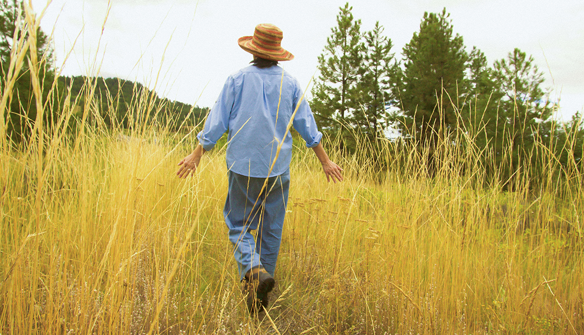 Woman Walking in Tall Yellow Grass, What Is Respite Care? A Break for the Caregiver