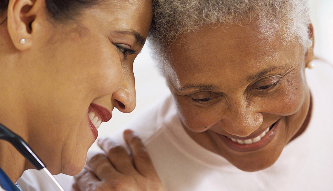 Female Nurse talking to mature patient, Get Help Paying for Loved One's Care