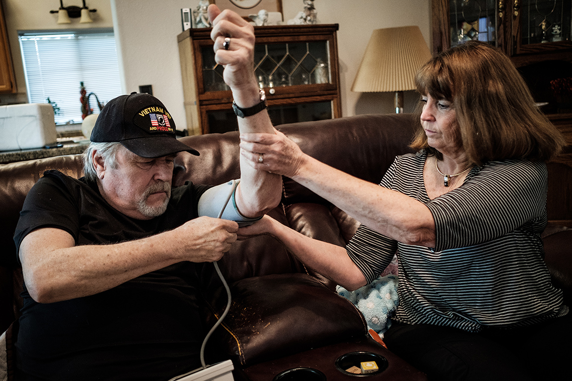 Debbie Sprague helps husband Randy take his blood pressure