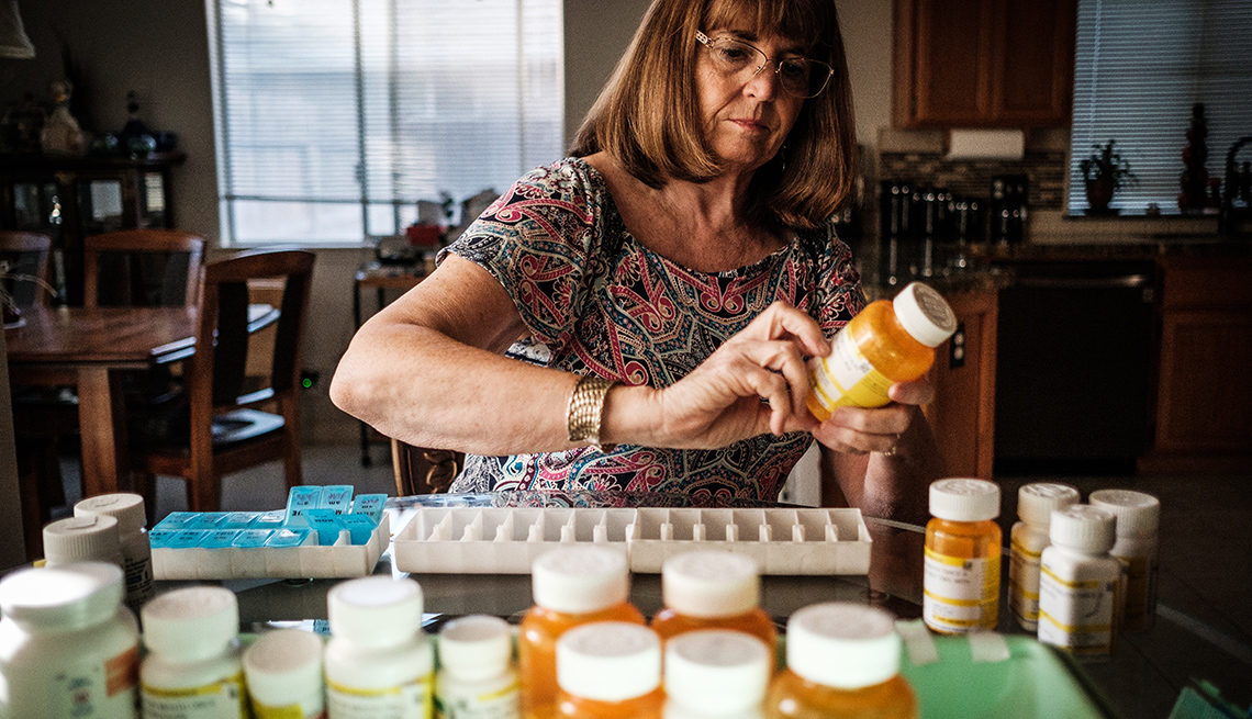 Debbie Sprague sorts medications for her husband, Vietnam veteran Randy Sprague