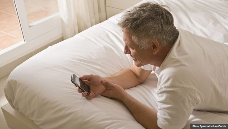 Advice and tips about dating and social media- a man texting on his smartphone