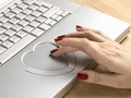 Woman using heart-shaped touchpad on laptop, How to stay safe when dating online