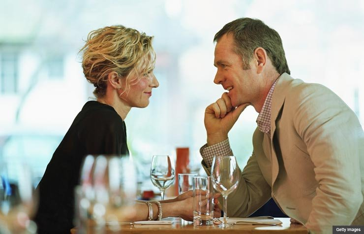 Couple sitting together at restaurant