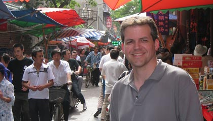 Ken at a street market in Xi'an, China while volunteering in 2009.