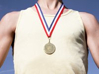 Raising an Olympic athlete- an athlete wearing a gold medal