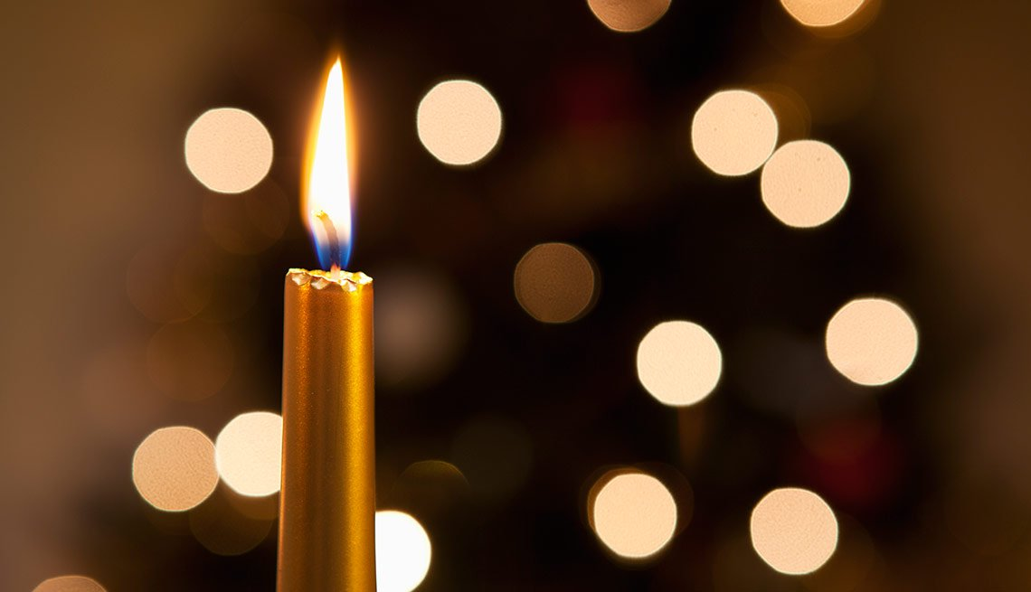 Candle with holiday lights