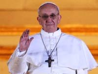Newly elected Pope Francis I waves from the balcony of St Peter's Basilica
