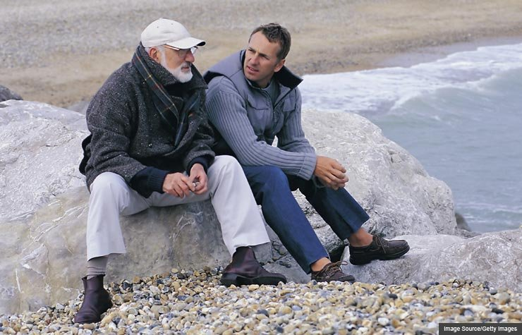 Father and son talking, Inheritance Etiquette (Image Source/Getty Images)