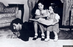 Hitting the books Marlo Thomas at 7, center, reads with father Danny and sister Terre. (Courtesy Marlo Thomas)