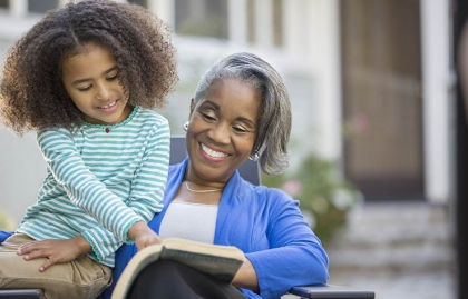 Grandmother and granddaughter reading together.