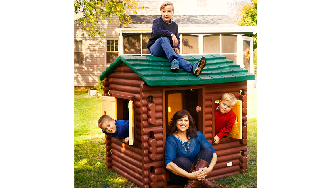Older Mom With Her Three Kids In The Backyard, AARP Home And Family, 50 Plus Moms