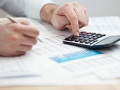 JBQ: Personal Finance 101 - Financial data analyzing. Counting on calculator. Money management.