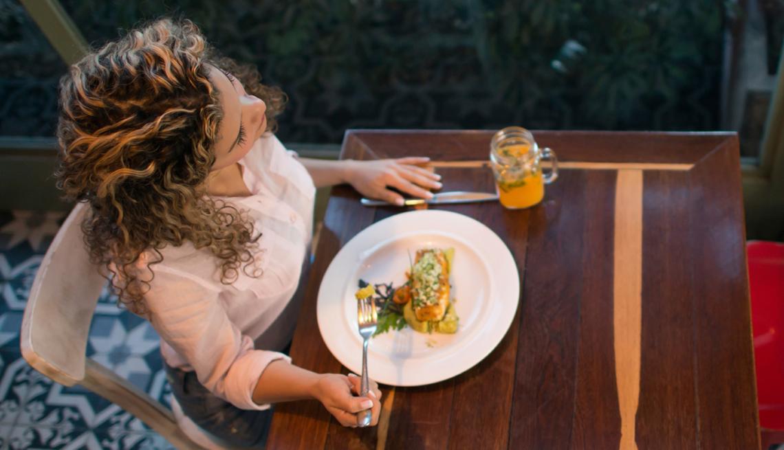 Woman having dinner at a restaurant