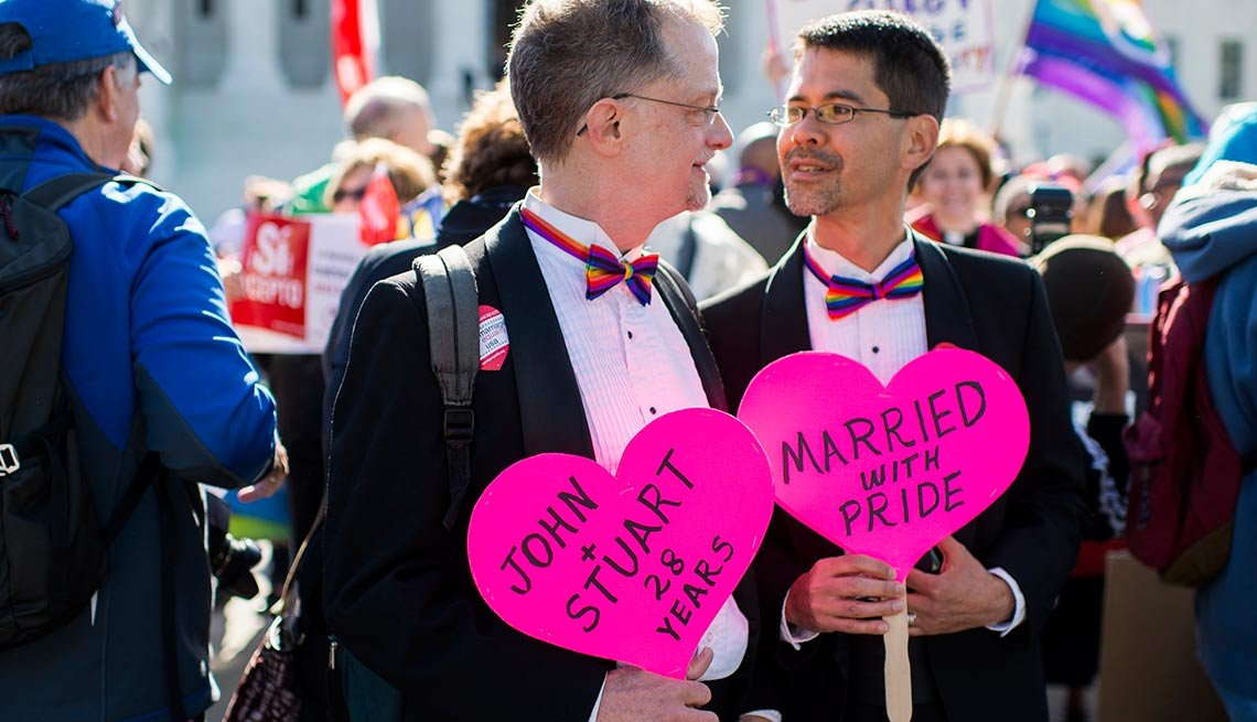 Married couple John Lewis, left, and Stuart Gaffney, of San Francisco, hold heart signs outside the U.S. Supreme Court before the start of oral arguments on marriage equality on Tuesday, April 28, 2015. Lewis and Gaffney were plaintiffs in the 2008 court case challenging California's same sex marriage ban.
