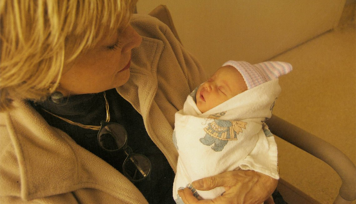 Lesley meeting baby Jordan for the first time