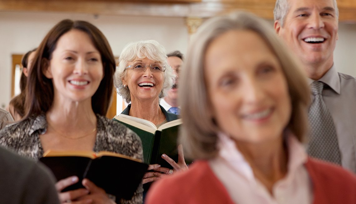 mature adults sing in a church