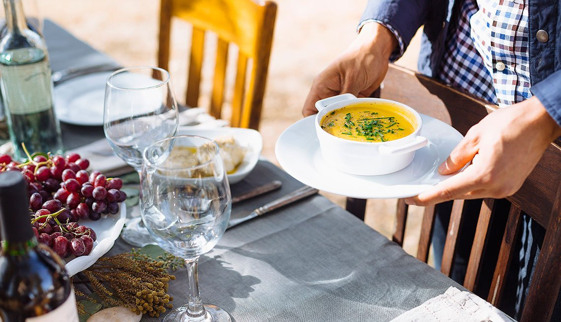 Man holding a soup dish