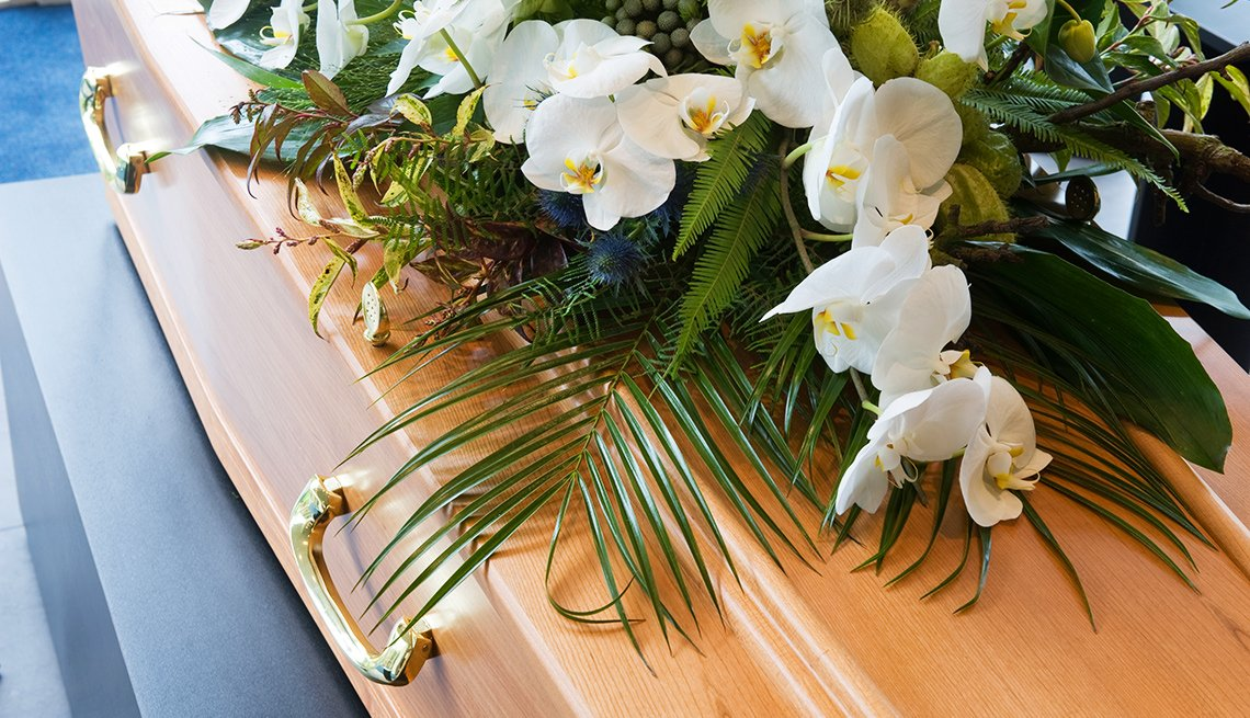 Coffin with floral arrangement