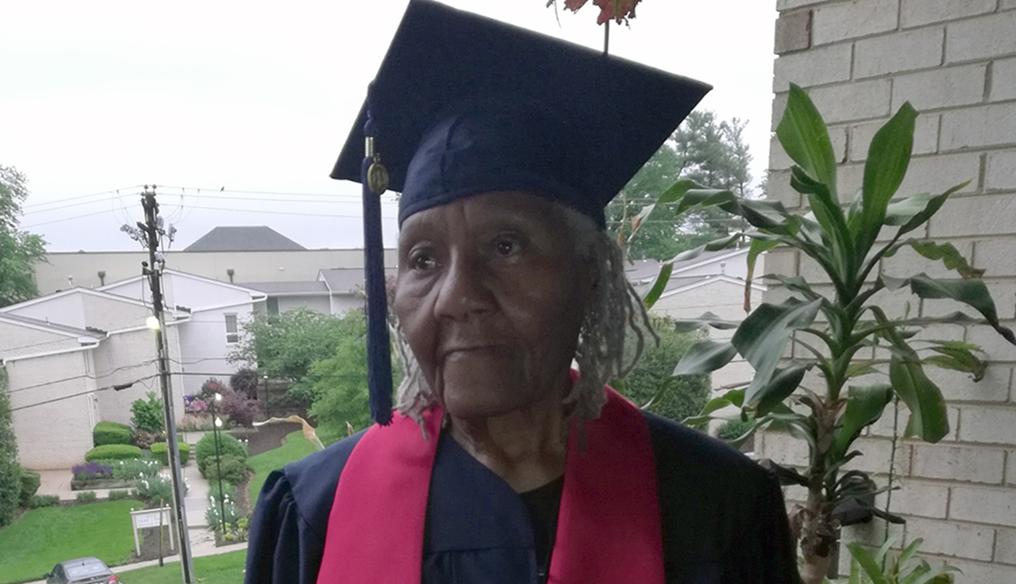 An older woman wearing a cap and gown