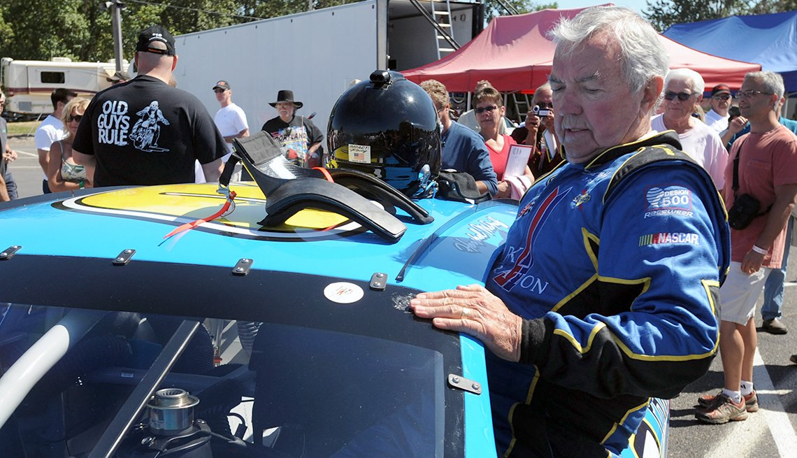 Hershel McGriff climbs into his car for qualifying for the NASCAR Camping World Series West, 90 year old NASCAR driver