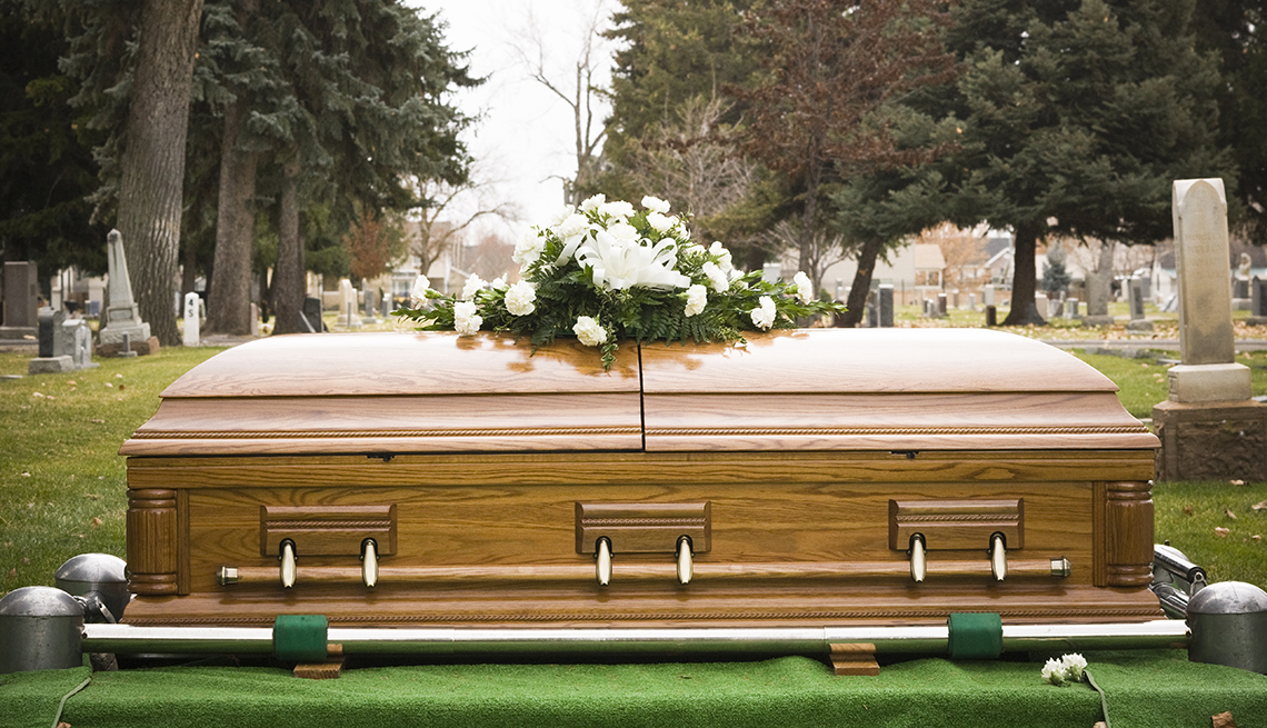 casket with flowers on top of it