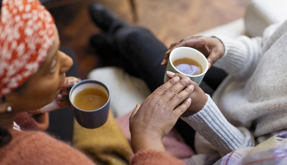 African-American women talking over coffee