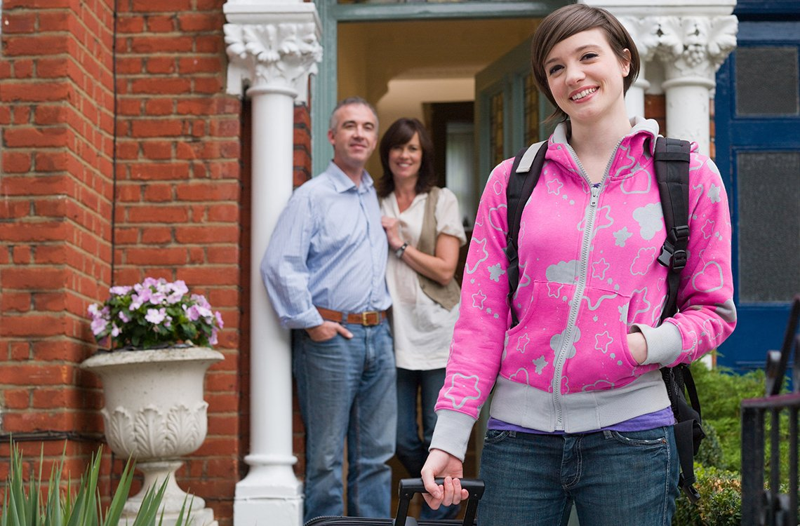 parents watching college student leaving home
