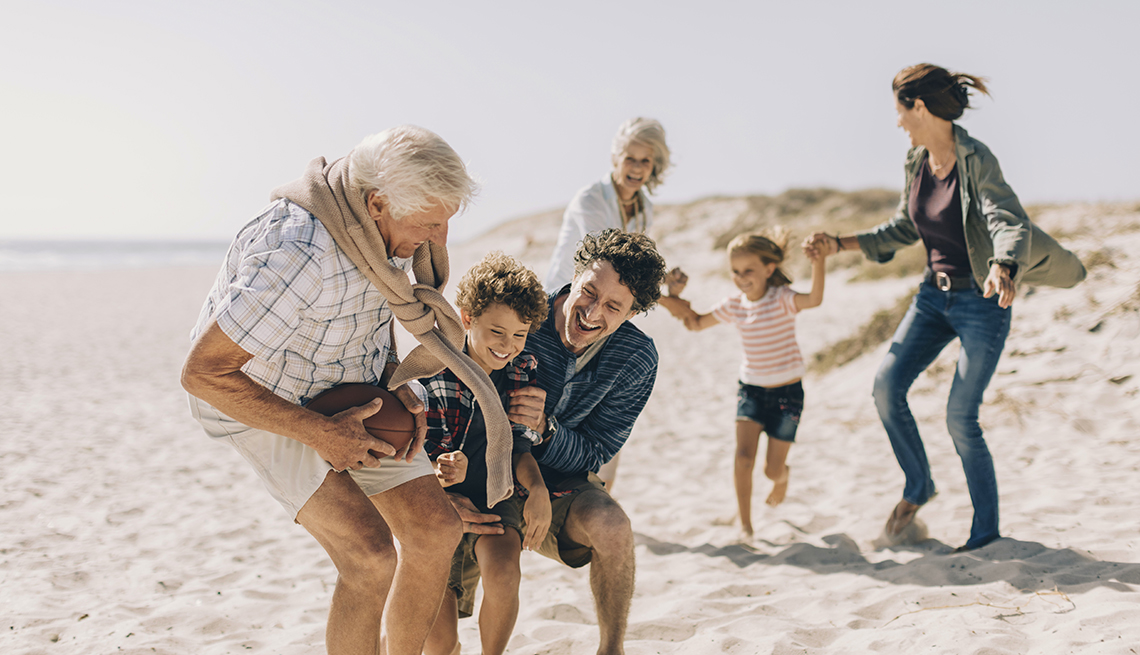 multi-generational family playing on the beach