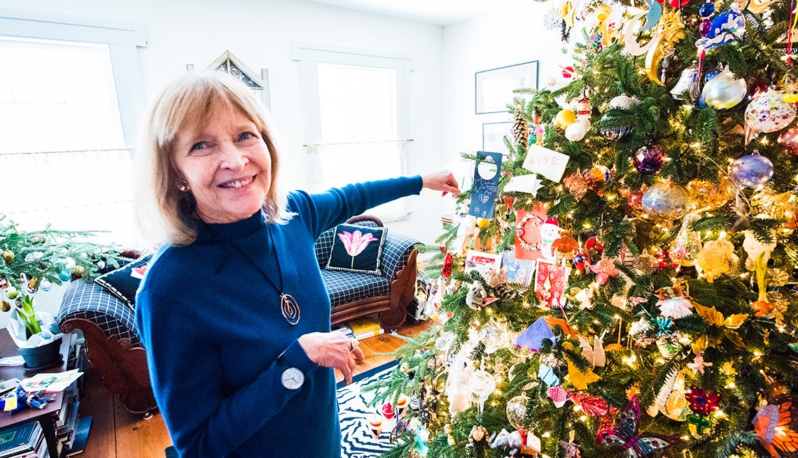 Bonnie Mackay standing in front of her Christmas tree.