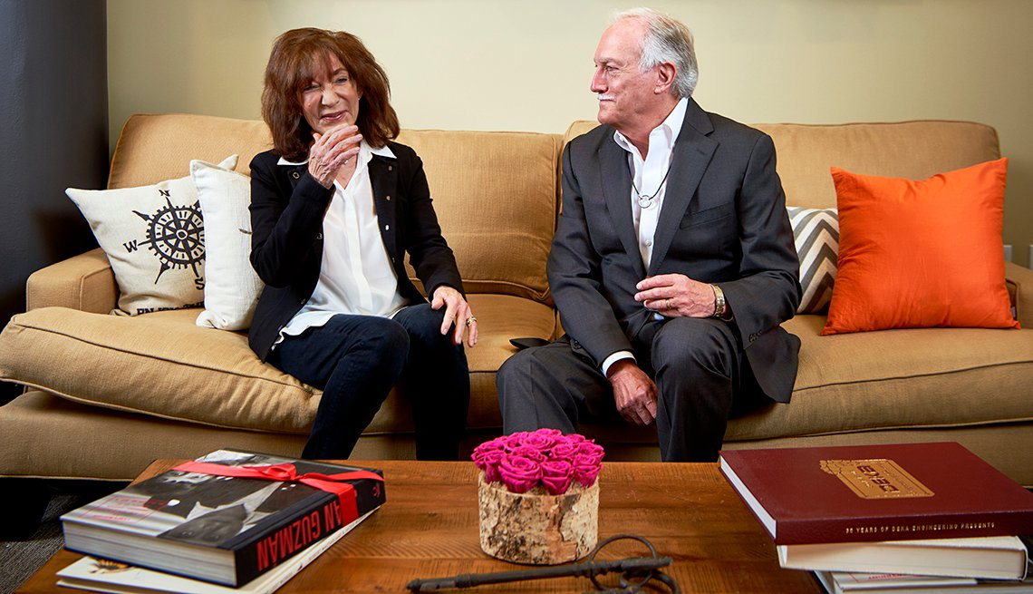 Jackie and Mike Bezos sitting on a couch