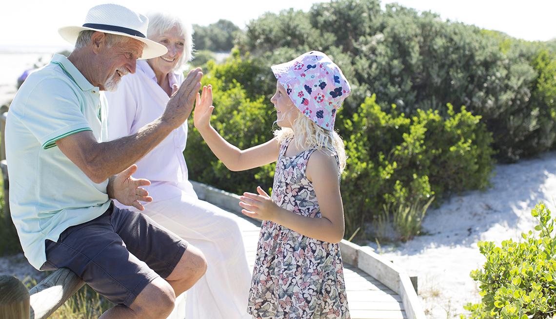 older man high fives a child