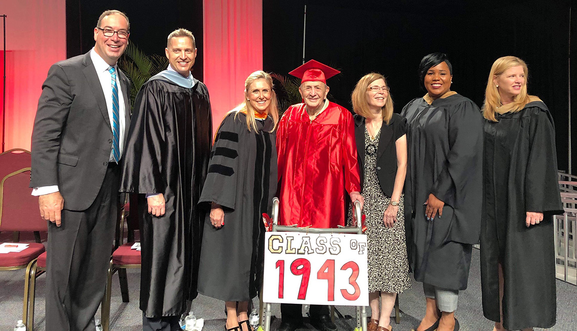 item 4, Gallery image. Joe Perricone on stage with family members and members of the Hillsborough County School Board.