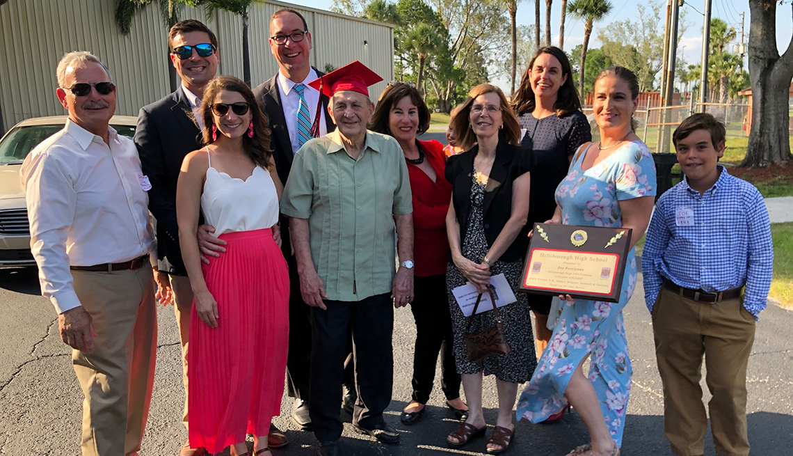 item 5, Gallery image. Joe Perricone and his family following the graduation ceremony at Hillsborough High School in Tampa. Fla.