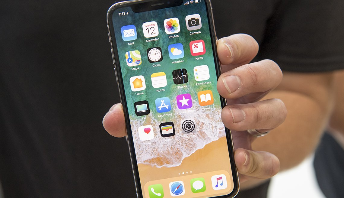An attendee displays an Apple Inc. iPhone X for a photograph during an event at the Steve Jobs Theater in Cupertino, California, U.S., on Tuesday, Sept. 12, 2017.