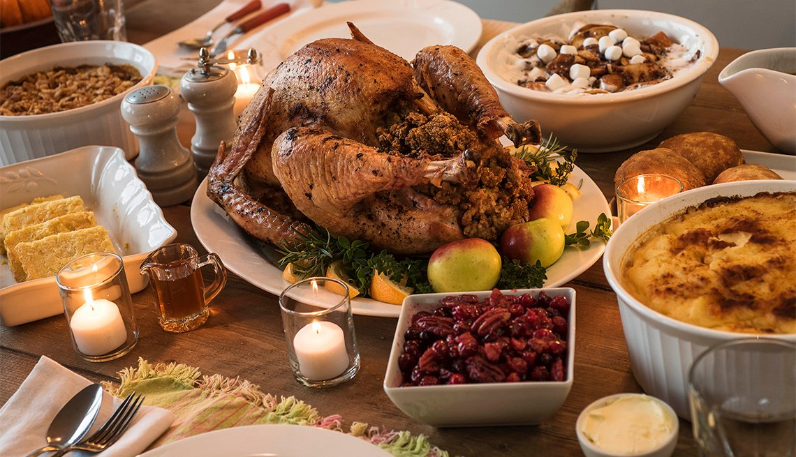 table set for Thanksgiving dinner with turkey, cornbread and more