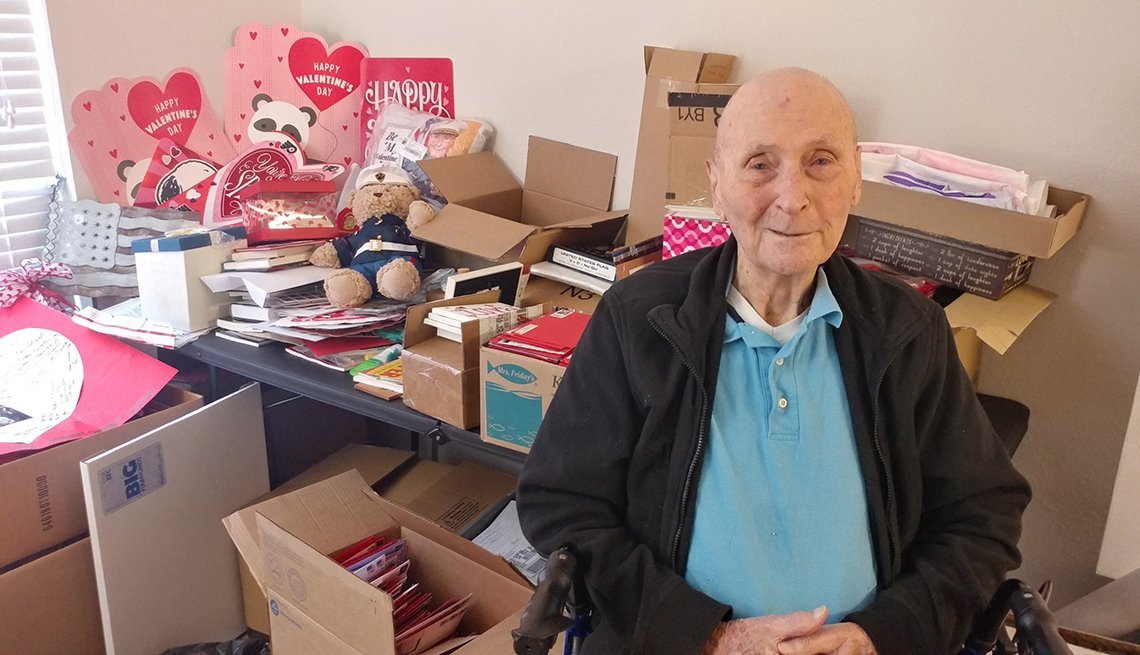 Bill White in a room surrounded by Valentine's Day cards