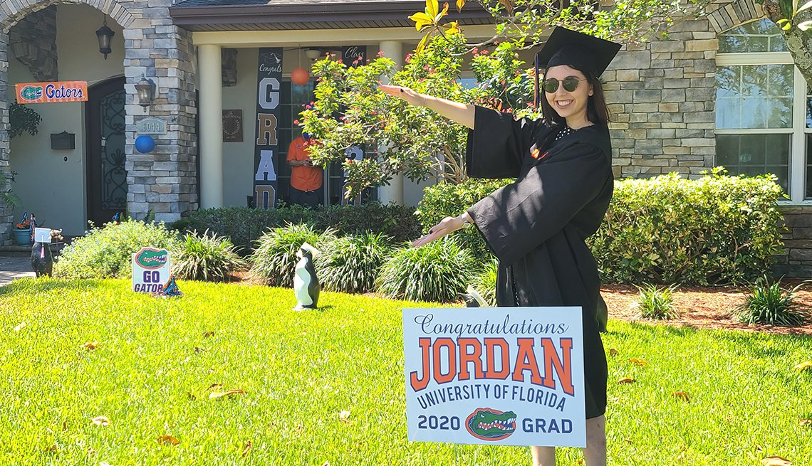 Jordan Kriseman poses in her front yard wearing her cap and gown
