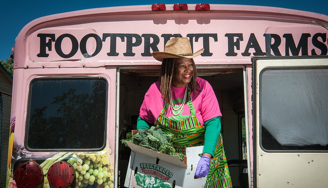 doctor cindy ayers elliott unloads produce from her farms pink bus