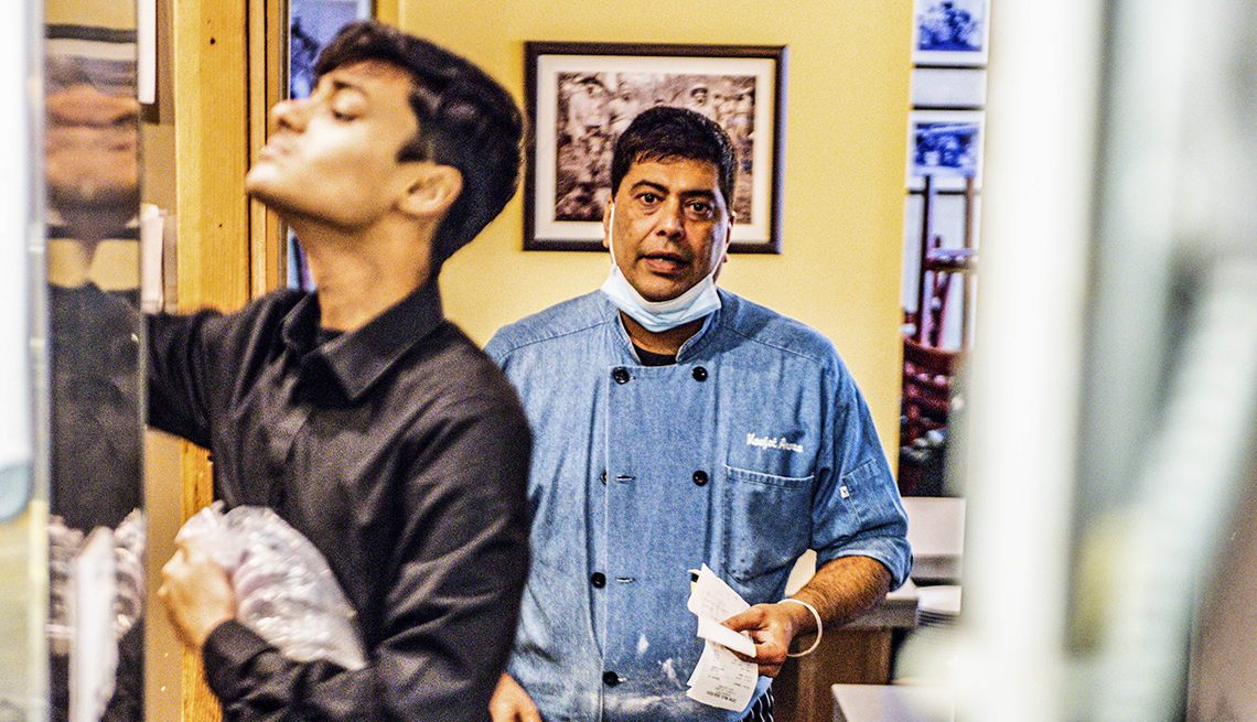 restauranteur navjot arora and one of his staff works in the kitchen