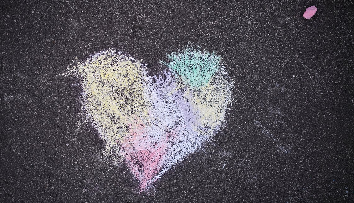 colorful heart shape drawn with sidewalk chalk on pavement