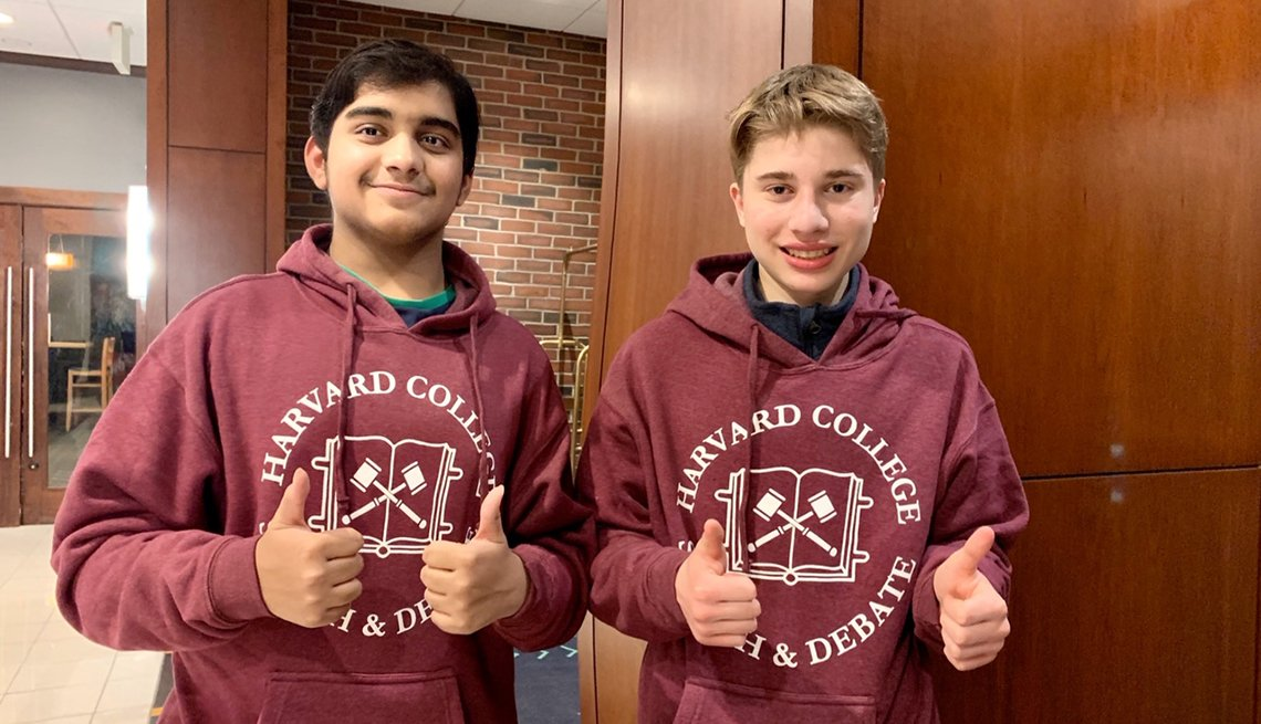 Dhruv and Matthew wearing Harvard College sweatshirts