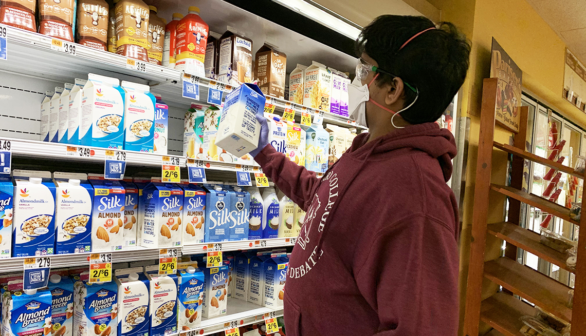 Dhruv buying milk at the grocery store