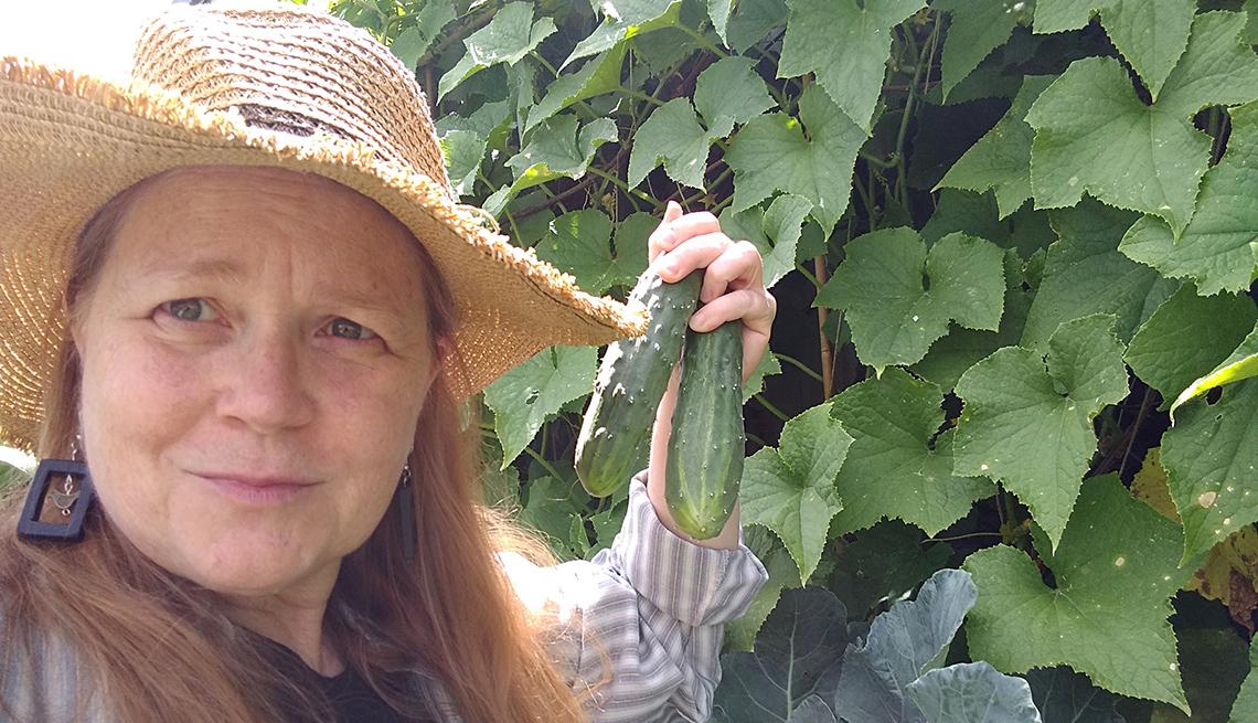 Teresa Konechne in her garden with cucumbers