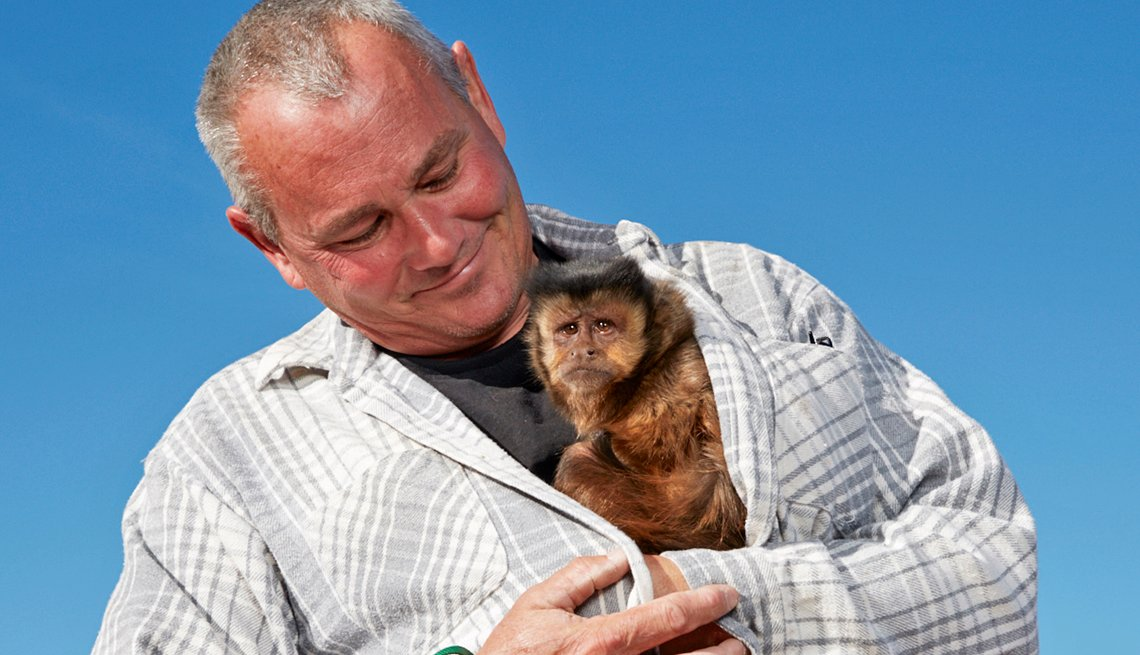 Joel Almquist, with his pet monkey Cheeky